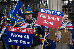 London, UK. 30 January, 2020. Steve Bray stands with fellow pro-EU activists from SODEM (Stand of Defiance European Movement) to begin a party outside Parliament on the eve of Brexit Day on the theme of 'Party like there's no tomorrow'.