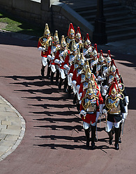 The Household Cavalry march outside St George's Chapel, Windsor Castle, Berkshire, before the funeral of the Duke of Edinburgh. Picture date: Saturday April 17, 2021.