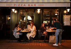 © Licensed to London News Pictures. 23/09/2020. London, UK. People eat and drink in a mostly quiet Soho in central London on the last night before the 10PM curfew comes into force. Prime Minister Boris Johnson has announced new measures to attempt to reduce the rising number of new Covid-19 infections. Photo credit: Peter Macdiarmid/LNP