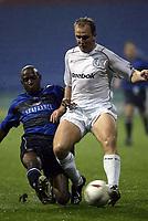 Photo. Aidan Ellis.<br />Bolton Wanderers v Gillingham.<br />Carling Cup 3rd Round.<br />28/10/2003.<br />Bolton's Henrik Pedersen and Giliingham's Ian Cox