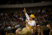 A fan of the Los Angeles Lakers celebrates after his team made a three-pointer against the Dallas Mavericks at the American Airlines Center in Dallas on Sunday, February 24, 2013. (Cooper Neill/The Dallas Morning News)