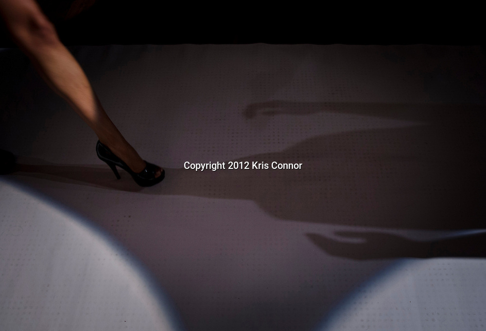 A model walks the runway during a fashion show during the Fashion Industry Networking Party at Dirty Bar in Washington DC on February 23, 2012.