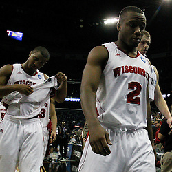 Mar 24, 2011; New Orleans, LA; Wisconsin Badgers guard Wquinton Smith (2) and teammates walk off the court following a loss to the Butler Bulldogs in the semifinals of the southeast regional of the 2011 NCAA men's basketball tournament at New Orleans Arena. Butler defeated Wisconsin 61-54.  Mandatory Credit: Derick E. Hingle