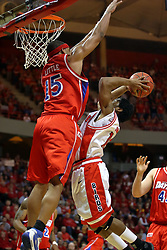 24 March 2008: Charles Little bests a shot attempt by Dominick Johnson. The Flyers of Dayton defeated the Redbirds of Illinois State 55-48 on Doug Collins Court inside Redbird Arena in Normal Illinois.
