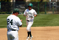 21 April 2007: Ricky Angel approaches 3rd base and his coach Dennis Martel on his homerun trot.  Carthage College loses the first game of a double header by a score of 5-2 against the Illinois Wesleyan Titans.