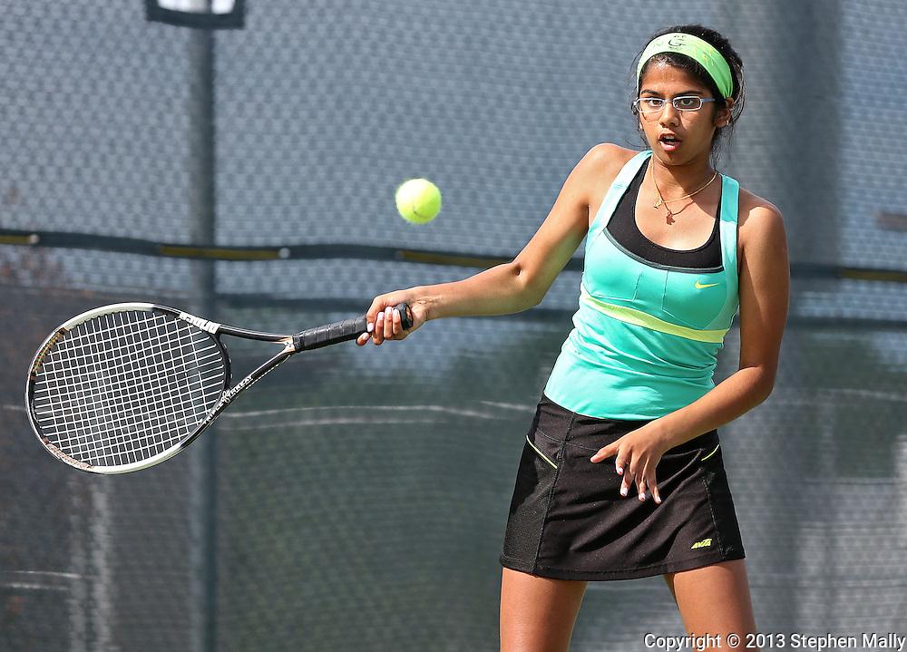 Iowa City West's Navya Mannengi returns the ball during the Class 2A state team tennis tournament at Veterans Memorial Tennis Center in Cedar Rapids on Saturday, June 1, 2013.