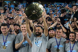 April 13, 2018 - Sydney, NSW, U.S. - SYDNEY, NSW - APRIL 13: Sydney FC midfielder Alex Brosque (14) lifts the Premiers plate with team mates in front of the cove at the A-League Soccer Match between Sydney FC and Melbourne Victory on April 13, 2018 at Allianz Stadium in Sydney, Australia. (Photo by Speed Media/Icon Sportswire) (Credit Image: © Speed Media/Icon SMI via ZUMA Press)