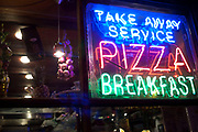 Neon pizza take away sign outside a restaurant in London
