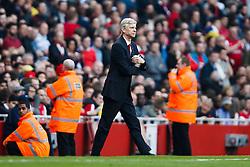 Arsenal Manager Arsene Wenger (FRA) looks frustrated after Man City Midfielder David Silva (ESP) scores a goal - Photo mandatory by-line: Rogan Thomson/JMP - 07966 386802 - 29/03/14 - SPORT - FOOTBALL - Emirates Stadium, London - Arsenal v Manchester City - Barclays Premier League.