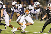 McNeil's Matthew Smith runs for yardage against Cedar Ridge Thursday at Kelly Reeves Athletic Complex.  (LOURDES M SHOAF for Round Rock Leader)
