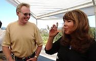 Len and Jessie Knapp, from San Bernardino, Calif., sample a glass of Iron Horse Brut Rosé sprakling wine at Iron Horse Vineyard in Sebastopol, Calif. on Saturday Sept. 27, 2003. (Photo by Jakub Mosur)