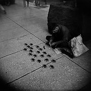 A man makes spiders made out of pipe cleaners to sell them on Madero pedestrian street in the historic center of Mexico City, on Apr. 3, 2020. This popular street was later closed to the public to avoid crowds.