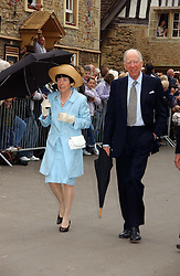 LORD & LADY ROTHSCHILD at the wedding of Laura Parker Bowles to Harry Lopes held at Lacock, Wiltshire on 6th May 2006.<br />