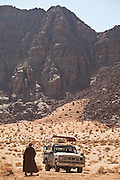 Bedouin guide Etzal Salem walks to his pickup truck in the desert in Wadi Rum, Jordan.