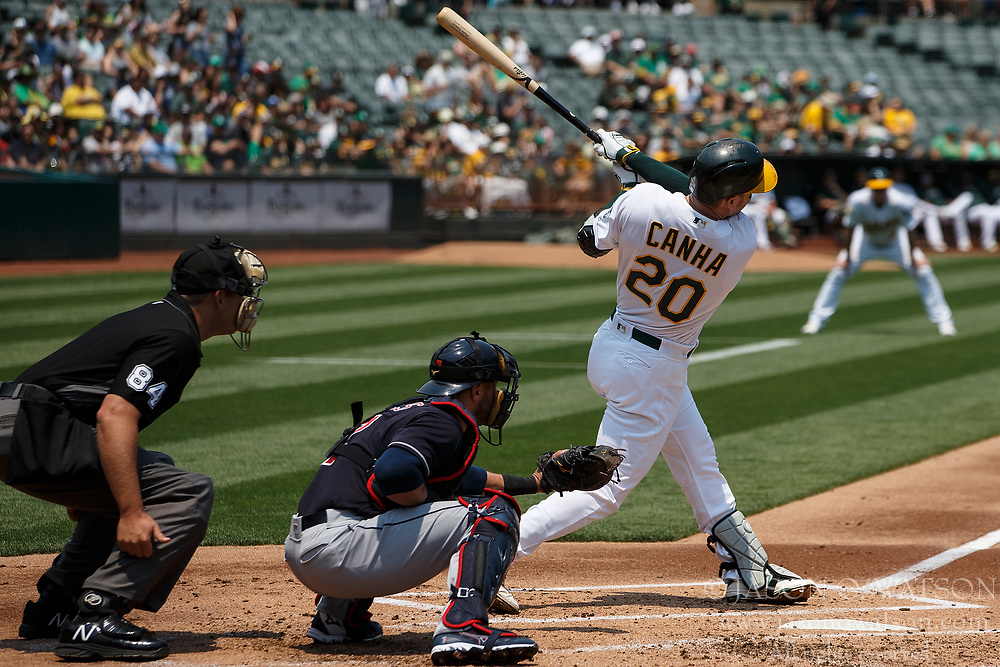 OAKLAND, CA - JULY 01:  Mark Canha #20 of the Oakland Athletics at bat against the Cleveland Indians during the first inning at the Oakland Coliseum on July 1, 2018 in Oakland, California. The Cleveland Indians defeated the Oakland Athletics 15-3. (Photo by Jason O. Watson/Getty Images) *** Local Caption *** Mark Canha