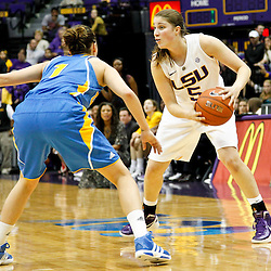 December 13, 2011; Baton Rouge, LA; LSU Lady Tigers guard Jeanne Kenney (5) is defended by UCLA Bruins guard Thea Lemberger (1) during the first half of a game at the Pete Maravich Assembly Center.  Mandatory Credit: Derick E. Hingle-US PRESSWIRE