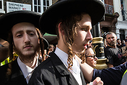 London, UK. 10th June, 2018. Orthodox Haredi Jews from Neturei Karta are abused by pro-Israel activists (out of picture) as they arrive to take part in the pro-Palestinian Al Quds Day march through central London organised by the Islamic Human Rights Commission. An international event, it began in Iran in 1979. Quds is the Arabic name for Jerusalem.
