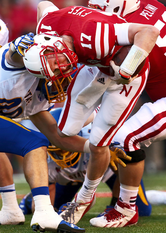 Nebraska quarterback Ryker Fyfe (17) is brought down by South Dakota Sate defensive back Nick Mears (40) after a 3 yard carry late in the fourth quarter of Saturday's game at Memorial Stadium in Lincoln. Nebraska defeated South Dakota State 59-20. (Independent/Matt Dixon)