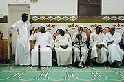 """Old Nubians sitting at the back of a mosque waiting for """"Katb Al Kitab"""" event of """"Matrimony Contract"""" to start"""