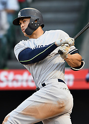 April 29, 2018 - Anaheim, CA, U.S. - ANAHEIM, CA - APRIL 29: New York Yankees designated hitter Giancarlo Stanton (27) hits a double in the fourth inning of a game against the Los Angeles Angels of Anaheim played on April 29, 2018 at Angel Stadium of Anaheim in Anaheim, CA. (Photo by John Cordes/Icon Sportswire) (Credit Image: © John Cordes/Icon SMI via ZUMA Press)