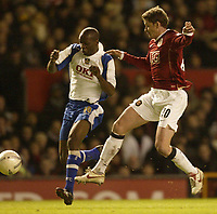 Photo: Aidan Ellis.<br /> Manchester United v Portsmouth. The FA Cup. 27/01/2007.<br /> united's ole Gunnar Solskjaer battles with Pompey's Lauren
