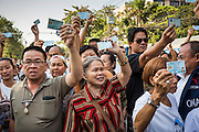 """01 FEBRUARY 2014 - BANGKOK, THAILAND: Thai voters hold up their national ID cards during a march to a polling place to try to vote. The voters were turned back by police who blocked access to the polls because armed anti-government protestors would not allow voters to cast their ballots. Thais went to the polls in a """"snap election"""" Sunday called in December after Prime Minister Yingluck Shinawatra dissolved the parliament in the face of large anti-government protests in Bangkok. The anti-government opposition, led by the People's Democratic Reform Committee (PDRC), called for a boycott of the election and threatened to disrupt voting. Many polling places in Bangkok were closed by protestors who blocked access to the polls or distribution of ballots. The result of the election are likely to be contested in the Thai Constitutional Court and may be invalidated because there won't be quorum in the Thai parliament.    PHOTO BY JACK KURTZ"""