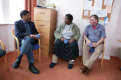 Support worker; development agency and tenant involved in a partnership meeting to discuss residents new home and tenancy ,