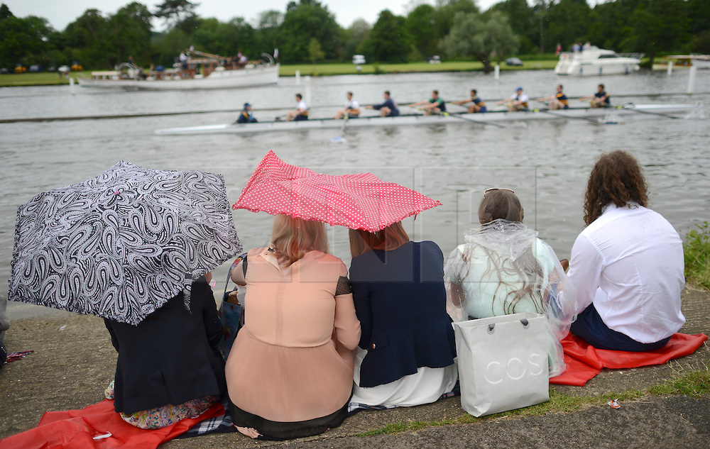 © Licensed to London News Pictures. 27/06/2012. Henley-on-Thames, UK Spectators watch rowing crews compete at the Henley Royal Regatta in the rain on June 26, 2012 in Henley-on-Thames, England. The 172-year-old rowing regatta is held 27th June- 1st July 2012. Photo credit : Stephen Simpson/LNP
