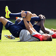 Jozy Altidore, (right), stretching with team mates during the New York Red Bulls Vs Portland Timbers, Major League Soccer regular season match at Red Bull Arena, Harrison, New Jersey. USA. 24th May 2014. Photo Tim Clayton