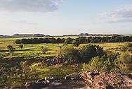 Kakadu National Park, Australia - September 5, 2017: Late afternoon light viewed from Nadab lookout at Ubirr illuminates the Nadab floodplain and Arnhem Land.
