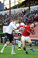 Barnsley forward Cauley Woodrow (25) and Charlton Athletic defender Patrick Bauer (5) battle for the ball during the EFL Sky Bet League 1 match between Barnsley and Charlton Athletic at Oakwell, Barnsley, England on 29 December 2018.