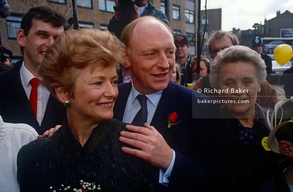 """Leader of the Labour party, Neil Kinnock and wife Glenys campaign during the 1992 election on 5th May 1992, in London, UK. Labour made considerable progress in the election that year reducing the Conservative majority to just 21 seats. It came as a shock to many when the Conservatives won a majority, but the """"triumphalism"""" perceived by some observers of a Labour party rally in Sheffield may have helped put floating voters off. Neil Gordon Kinnock, Baron Kinnock PC (b1942) is a British Labour Party politician. He served as a Member of Parliament from 1970 until 1995, first for Bedwellty and then for Islwyn. He was the Leader of the Labour Party and Leader of the Opposition from 1983 until 1992, making him the longest-serving Leader of the Opposition in British political history."""
