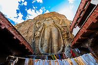 The Mulbekh Chamba, a 9 meter tall (30 feet) rock carving of a Maitreya Buddha, Mulbekh, Ladakh, Jammu and Kashmir State, India.