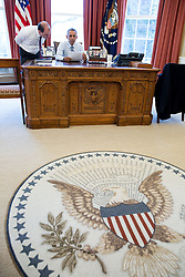 President Barack Obama, with Ben Rhodes, Deputy National Security Advisor for Strategic Communications,  goes over his statement on the Joint Comprehensive Plan of Action regarding Iran's nuclear program, in the Oval Office, April, 2, 2015. (Official White House Photo by Pete Souza)<br /> <br /> This official White House photograph is being made available only for publication by news organizations and/or for personal use printing by the subject(s) of the photograph. The photograph may not be manipulated in any way and may not be used in commercial or political materials, advertisements, emails, products, promotions that in any way suggests approval or endorsement of the President, the First Family, or the White House.