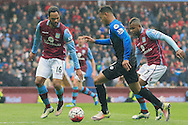 Joshua King of Bournemouth (C) in action with Joleon Lescott (L) and Leandro Bacuna of Aston Villa.<br /> Barclays Premier League match, Aston Villa v AFC Bournemouth at Villa Park in Birmingham, The Midlands on Saturday 09th April 2016.<br /> Pic by Ian Smith, Andrew Orchard Sports Photography.