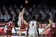 Southern California Trojans guard Drew Peterson (13) shoots over Stanford Cardinal guard Michael O'Connell (5) during an NCAA men's basketball game, Wednesday, March 3, 2021, in Los Angeles. USC defeated Stanford 79-42. (Jon Endow/Image of Sport)