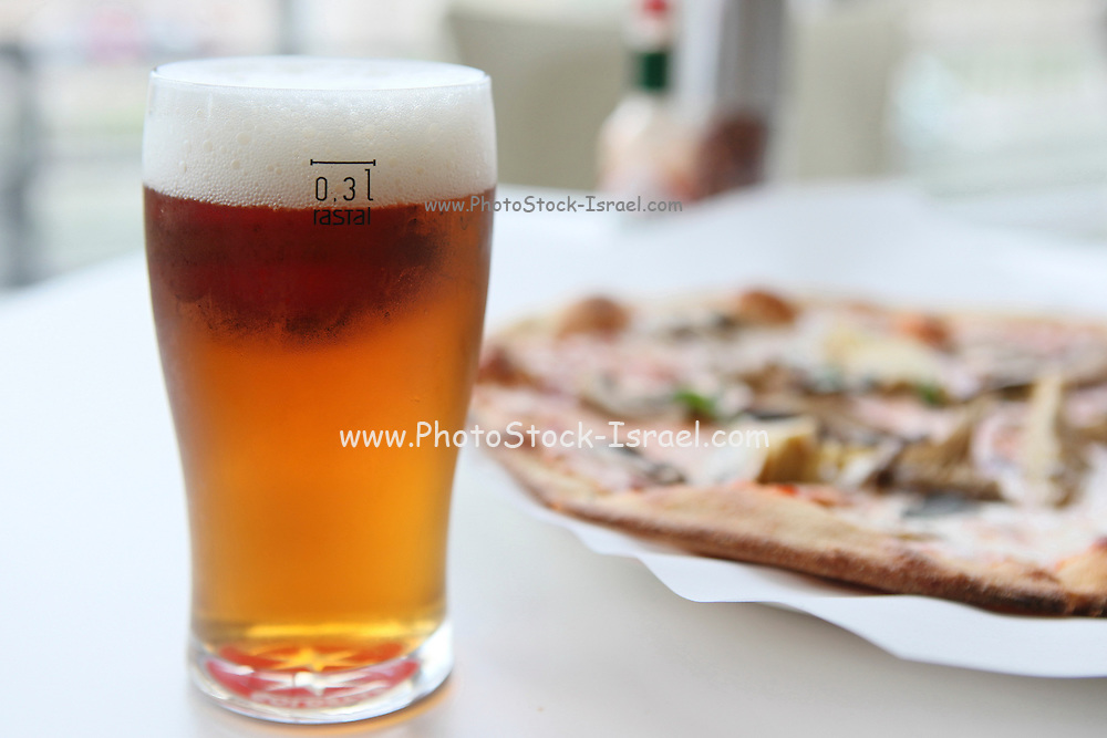 Freshly baked mushroom pizza served with beer