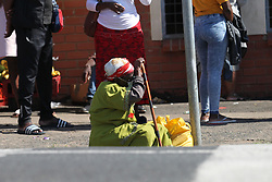 South Africa- Durban - 05 May 2020 - An old woman gets tired from standing on a long queue to get her medication inStanger hospital in kwaDukuza as it has been closed down after a number of patients and staff tested positive for corona virus<br /> Picture: Doctor Ngcobo/African News Agency(ANA)