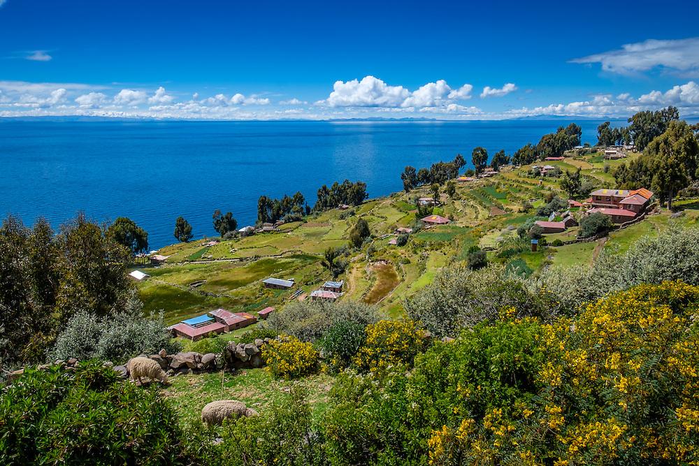 Terraces in Taquile Island and view of Lake Titicaca, Peru.
