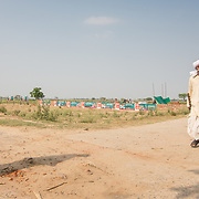 CAPTION: The OORJAgram Rural Enterprise Zone is being strategically constructed at the intersection of two roads. LOCATION: Diara Rasulpur, Saran District, Bihar, India. INDIVIDUAL(S) PHOTOGRAPHED: From left to right - Bindheswan Kumar and Sudama Rai.