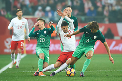 Wroclaw, Poland - 2016 November 14: (C) Pawel Wszolek of Poland fights for the ball with (L) Gregor Sikosek of Slovenia and (R) Rene Krhin of Slovenia during Poland v Slovenia - International Friendly Soccer Match at Municipal Stadium on November 14, 2016 in Wroclaw, Poland.<br /> <br /> Adam Nurkiewicz declares that he has no rights to the image of people at the photographs of his authorship.<br /> <br /> Picture also available in RAW (NEF) or TIFF format on special request.<br /> <br /> Any editorial, commercial or promotional use requires written permission from the author of image.<br /> <br /> Mandatory credit:<br /> Photo by © Adam Nurkiewicz / Mediasport