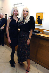 Left to right, NOELLE RENO and EMMA NOBLE at a private view of Bryan Adam's photographs entitled 'Modern Muses' held at The National Portrait Gallery, London on 11th March 2008.<br /><br />NON EXCLUSIVE - WORLD RIGHTS