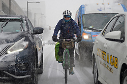 Philadelphia, PA, USA - February 20, 2019: Commuters get an early jump on rush hour as winter storm Petra brings several inches of snow to the Philadelphia region, on February 20, 2019. To accommodate, SEPTA implemented its Early Exit Schedule, running nine Regional Rail trains hours ahead of their normal schedules.