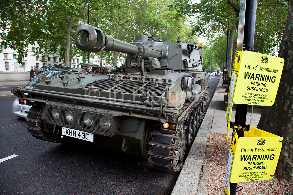 Tank parked on Victoria Embankment. Oxfam and Amnesty International, as part of the Control Arms coalition, drive an Abbot gun tank around central London to highlight the need for a global Arms Trade Treaty (ATT) to be agreed during a United Nations conference next month (July 2012). London, England, UK. 27th June 2012.