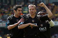 Photo: Tony Oudot.<br />Watford v Portsmouth. The Barclays Premiership. 09/04/2007.<br />Matt Taylor of Portsmouth celebrates his goal with Richard Hughes and Lomano Lualua