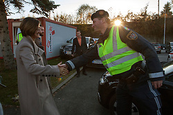 Licensed to London News Pictures. 06/11/2015. Spielfeld, Austria. Migrant crisis at the border crossing between Austria and Slovenia. Press Conference - Johanna Mikl-Leitner, Austrian Federal Minister for the Interior shaking hands with Austrian police officer. Photo: Marko Vanovsek/LNP