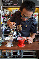 Piyachart Trithaworn and Natthiti Ampriwan take their coffee seriously - here it's about slow drip method.   Both men are photographers who have trained their baristas well, who are passionate and knowledgeable about their coffee and coffee in general