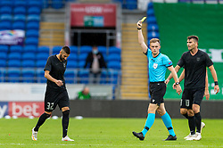 CARDIFF, WALES - Wednesday, August 19, 2020: FK FK Sarajevo's Benjamin Tatar is shown a yellow card by referee Jamie Robinson during the UEFA Champions League First Qualifying Round match between Connah's Quay Nomads FC and FK Sarajevo at the Cardiff City Stadium. FK Sarajevo won 2-0. (Pic by David Rawcliffe/Propaganda)