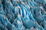 Crevasses in Grey Glacier, Southern Patagonian Ice Field, in Torres del Paine National Park, Chile, Patagonia, South America. Before dividing in two at its tongue, the glacier is 6 kilometers wide and over 30 meters high. Grey Glacier has receded 4 km and lost 17 square kilometers from the mid 1900s through 2010.  Torres del Paine National Park is listed as a World Biosphere Reserve by UNESCO.