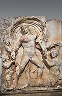 Close up of a Roman Sebasteion relief  sculpture of Emperor Claudius as God of sea and land,  Aphrodisias Museum, Aphrodisias, Turkey. <br /> <br /> The Emperor as god Claudius strides forward in a divine epiphany, drapery billowing around his head. He receives a cornucopia with fruits of the earth from a figure emerging from the ground, anda ship's steering oar from a marine tritoness with fish legs. The idea is clear: the god-emperor guarantees the prosperity of land and sea. The relief is a remarkable local visualisation - elevated and panegyrical - of the emperor's role as a universal saviour and divine protector. .<br /> <br /> If you prefer to buy from our ALAMY STOCK LIBRARY page at https://www.alamy.com/portfolio/paul-williams-funkystock/greco-roman-sculptures.html . Type -    Aphrodisias     - into LOWER SEARCH WITHIN GALLERY box - Refine search by adding a subject, place, background colour, museum etc.<br /> <br /> Visit our ROMAN WORLD PHOTO COLLECTIONS for more photos to download or buy as wall art prints https://funkystock.photoshelter.com/gallery-collection/The-Romans-Art-Artefacts-Antiquities-Historic-Sites-Pictures-Images/C0000r2uLJJo9_s0